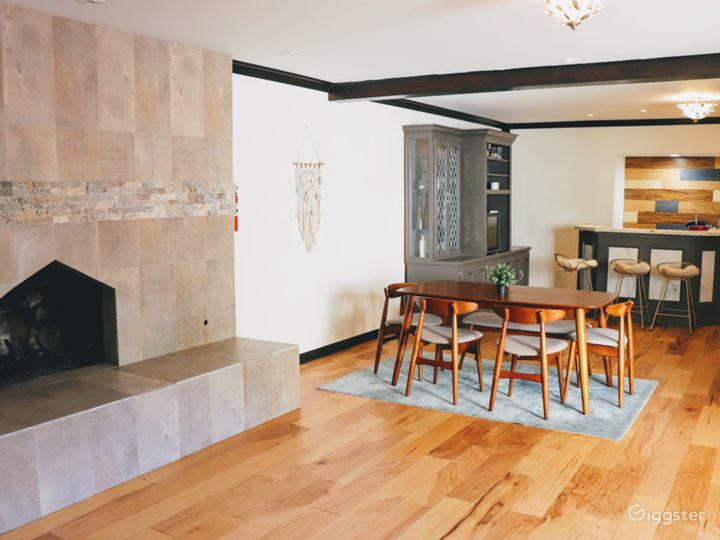 Living room with chimney, bar, dining table