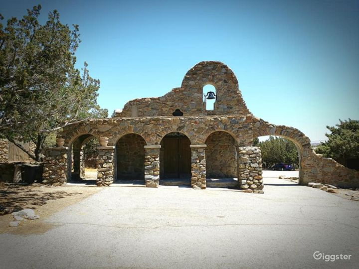 Mission style rock church in rural Acton on 40 ac