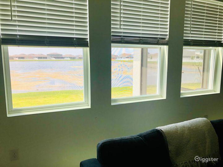 Living room windows to backyard and pond/water views