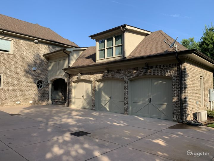 3 car garage with playroom on top