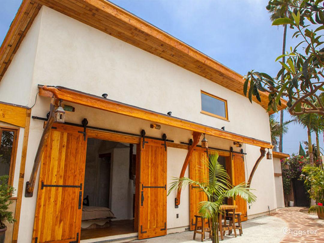 This open plan house features soaring eighteen foot ceilings, beyond custom woodwork, ceramics and sculpturally molded venetian plaster design.