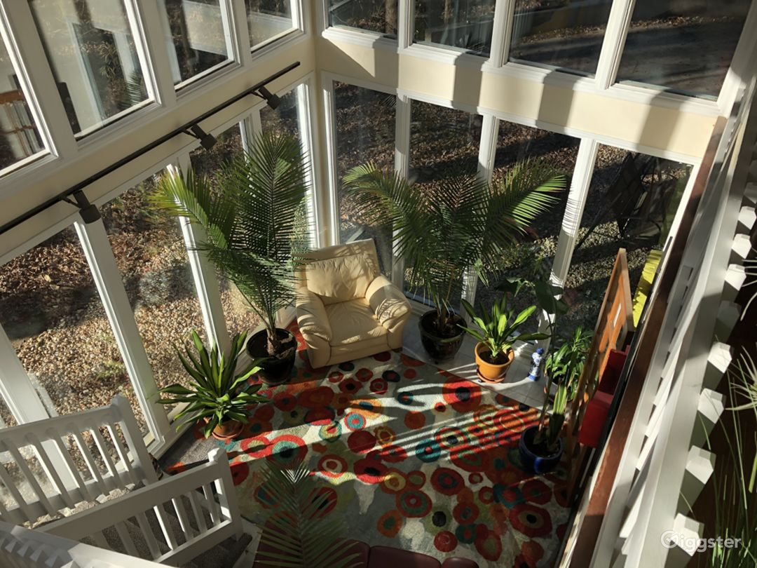 Looking down into two story sunroom