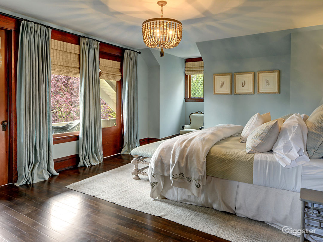 Master bedroom with private balcony overlooking Lake Washington