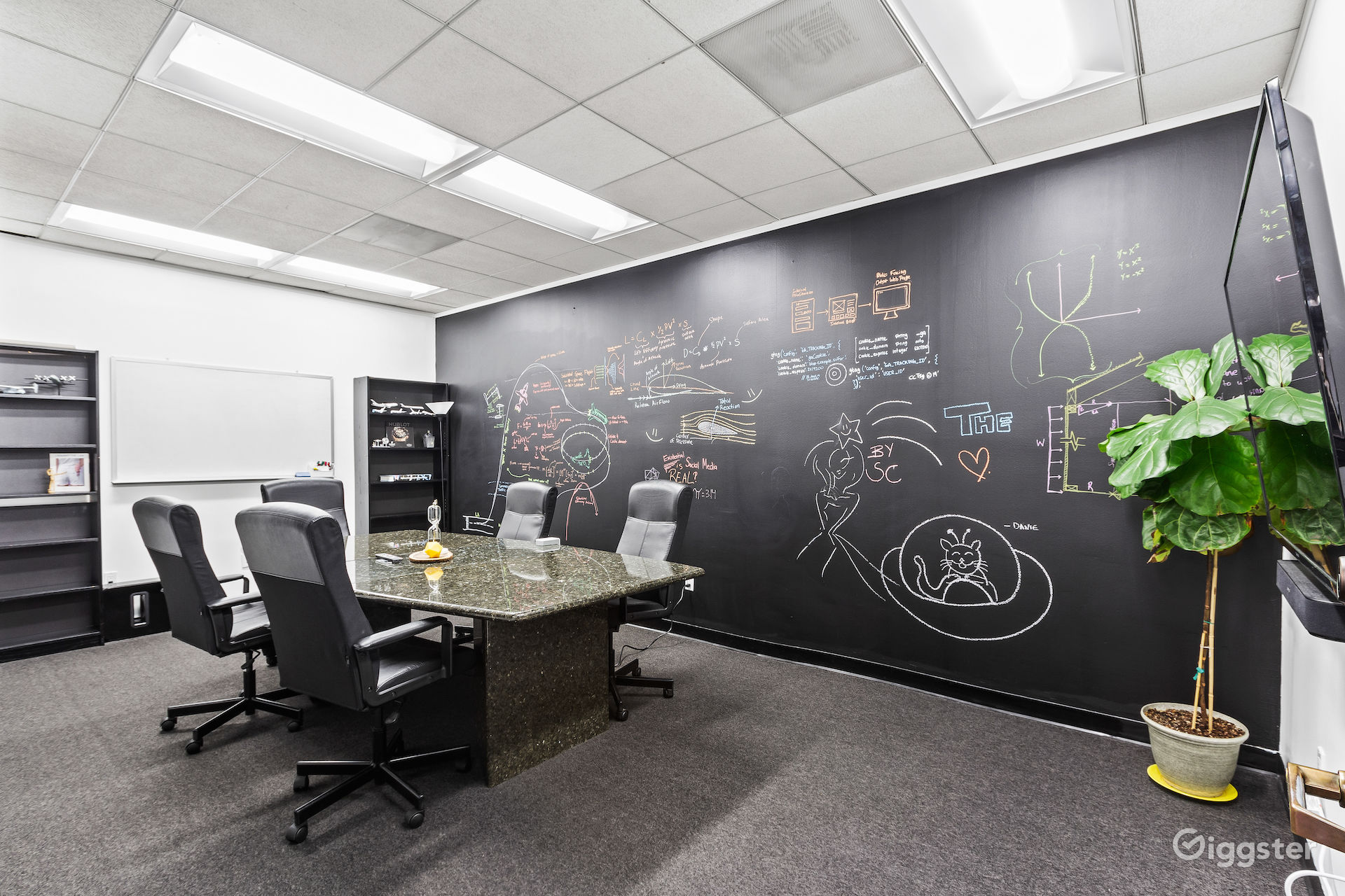 Hip & Creative Conference room in DTLA with White Board and Large Black Chalkboard Wall