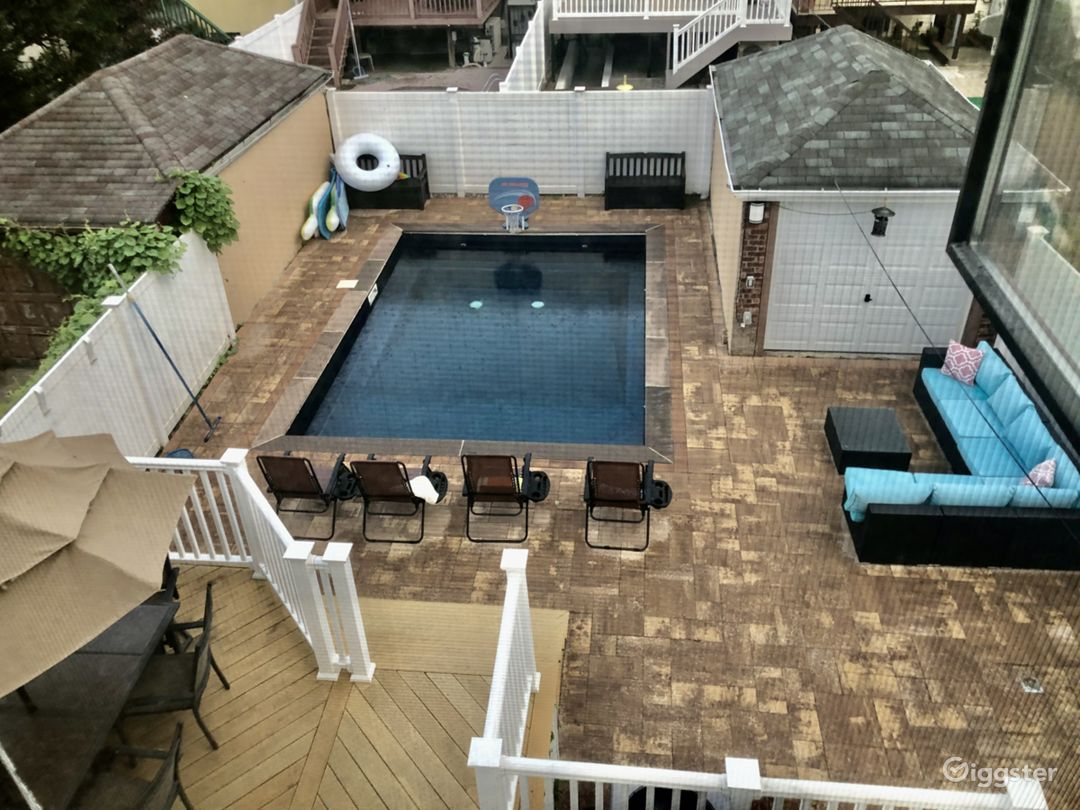 Large yard with new inground pool and neutral toned pavers
