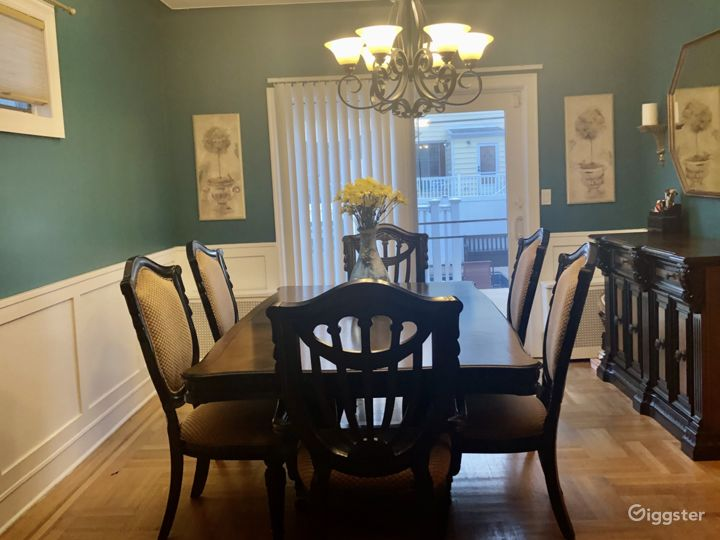 Dining room with traditional parquet floors and wainscoting on walls