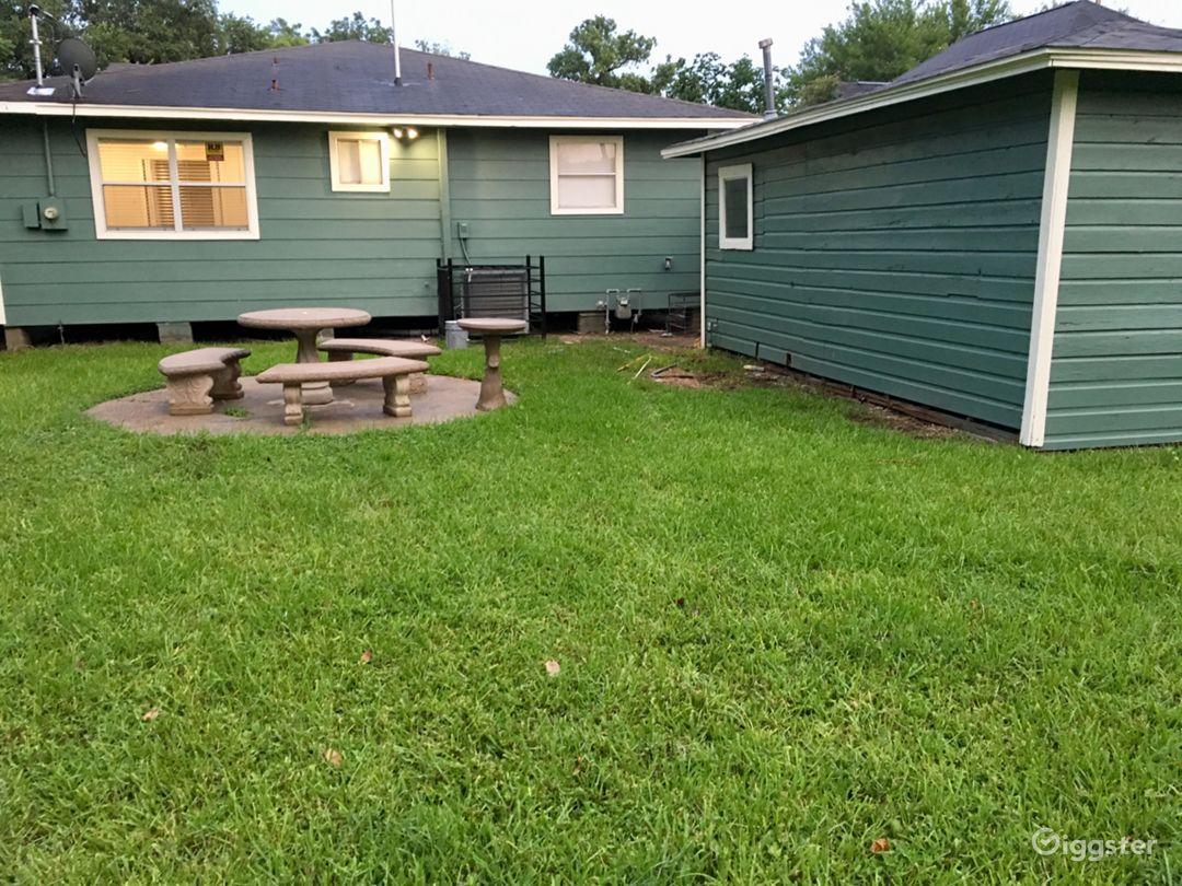 Huge backyard with stone table settings