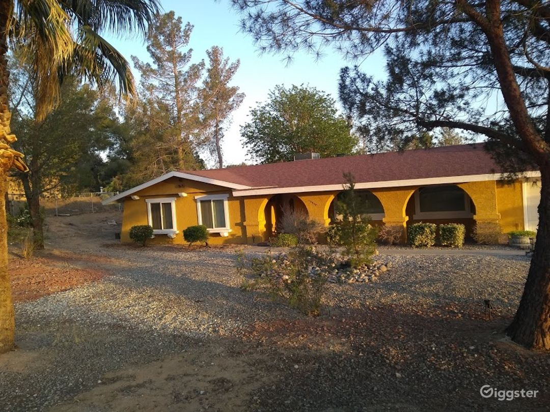 1970's Yellow House with Arches Photo 1
