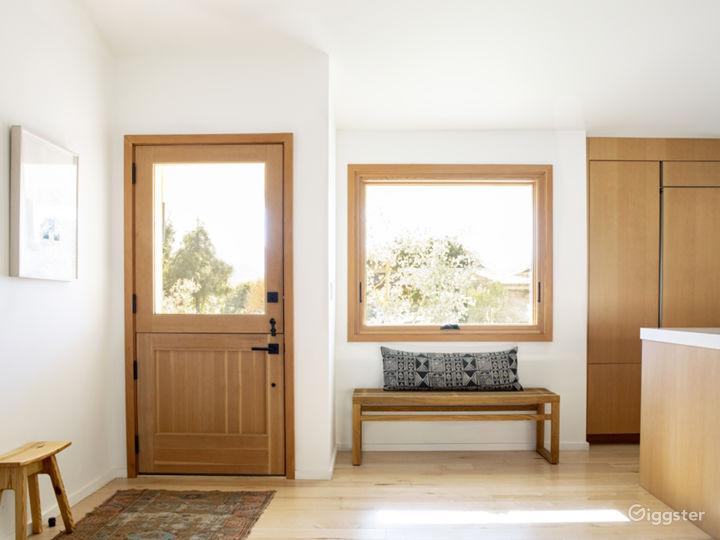 Entryway beside kitchen with dutch door and enormous large casement window.