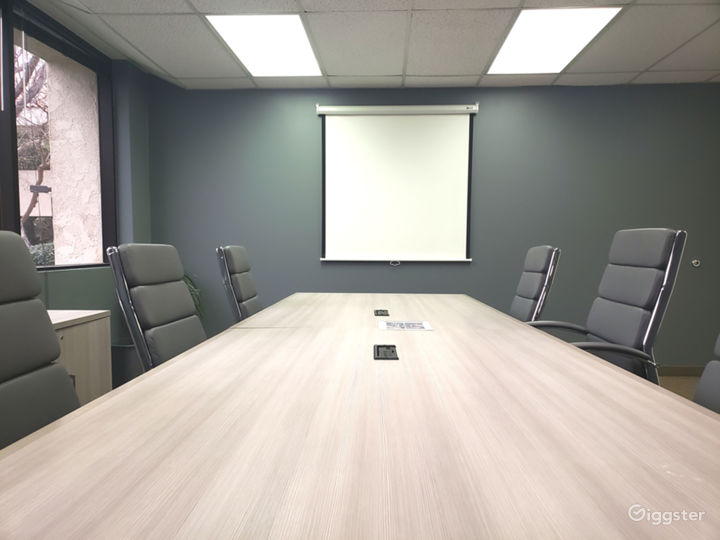 Conference Room with Projector Screen at officeLOCALE