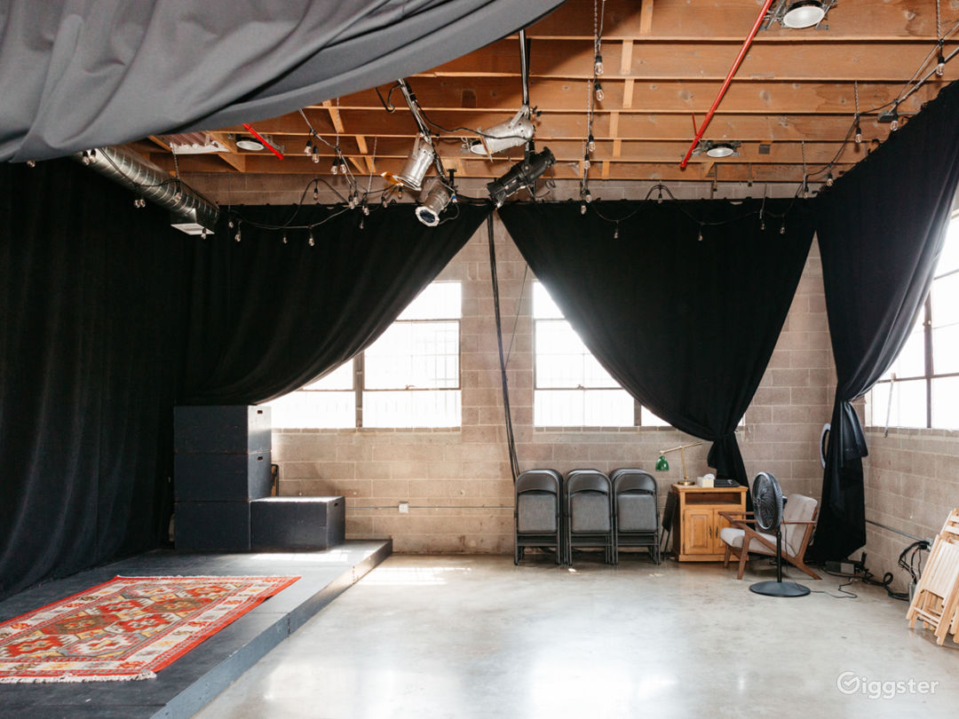 The lobby leads directly into the stage/presentation space. Curtains can black out or be drawn to let in natural light.