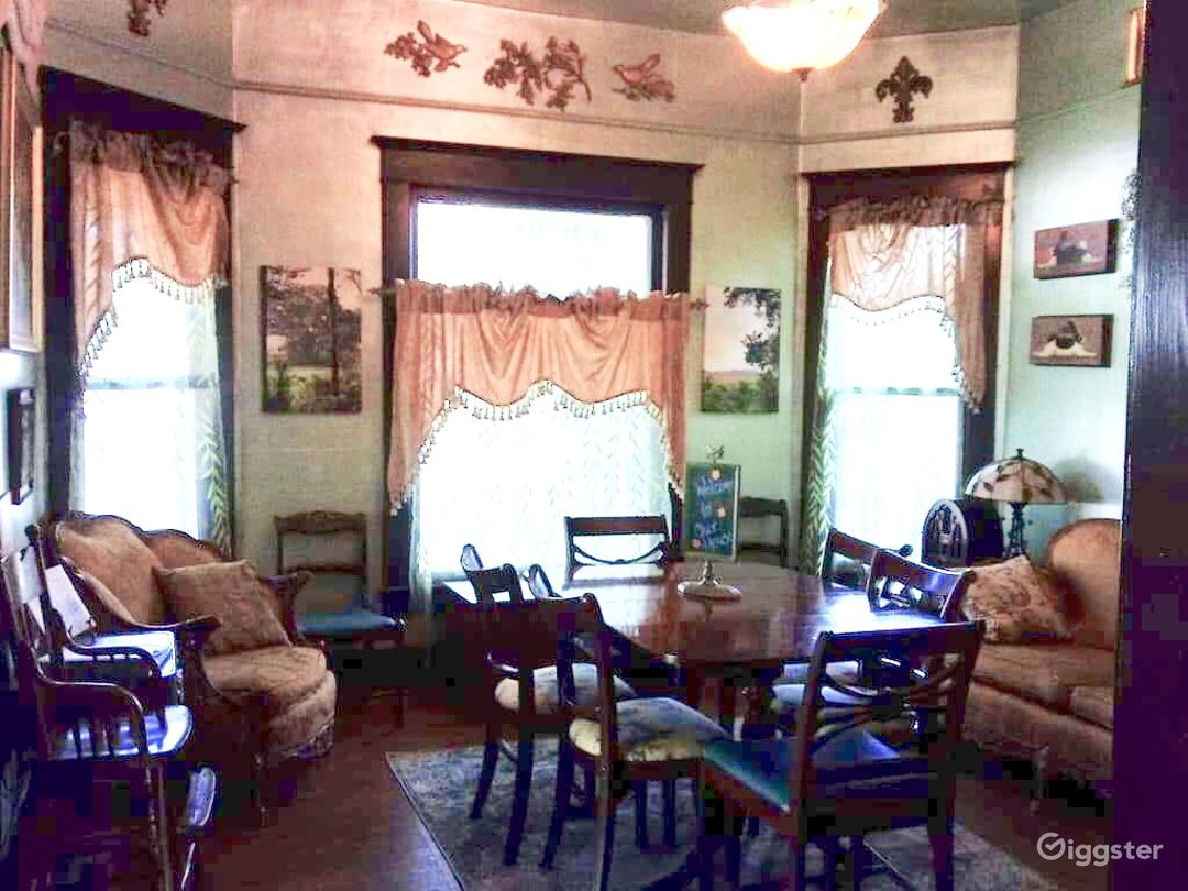 Original, over sized bay windows and antique furniture.