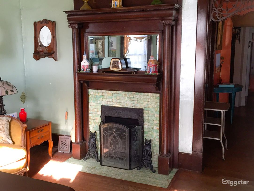 Original double mantel, tiger oak, coal or wood burning fireplace with original mirror and subway style tiles.