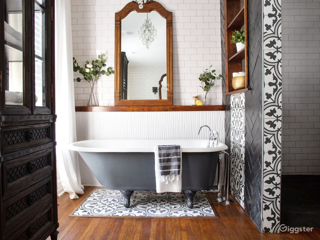 Large east-facing bathroom with two large windows, antique clawfoot tub and oversized shower.