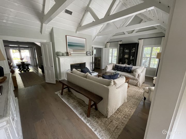 Vaulted tongue and groove ceilings with exposed beams and wood burning fireplace.