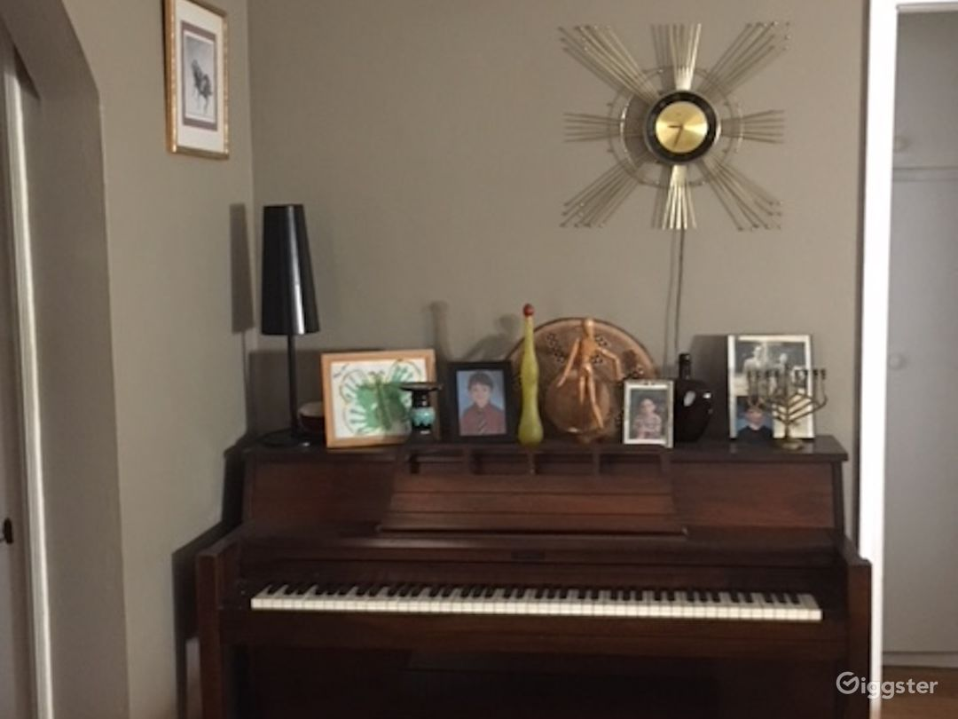 Entry, vintage piano and clock.
