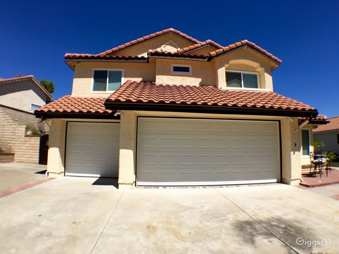 Spanish Style home lots of custom features dard hardwood floors and custom staircase
