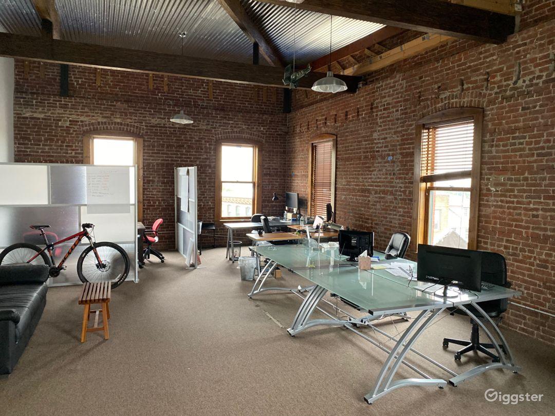 Exposed brick loft space, open floor plan -Views   Photo 4