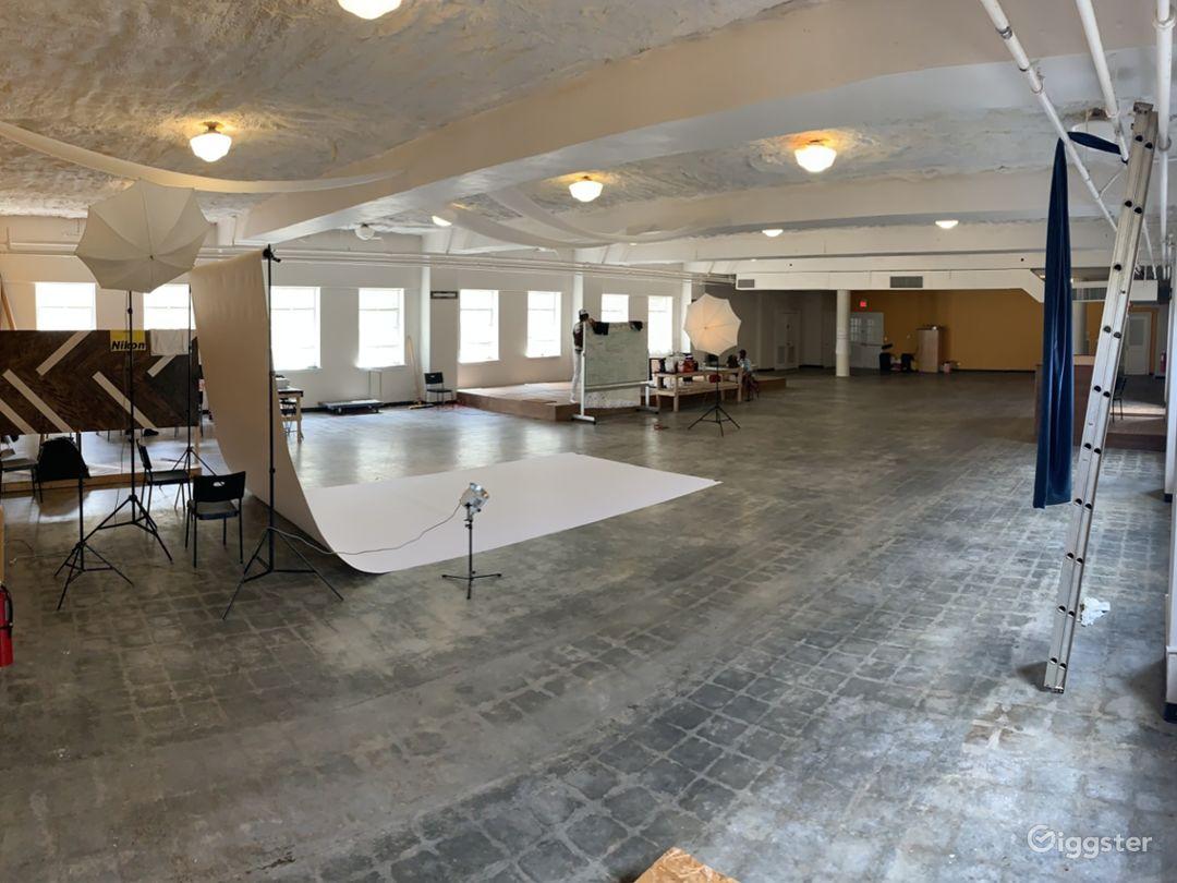 Wide short of studio w/ whitebackdrop