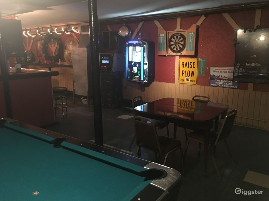 Pool/darts area next to the basement bar.