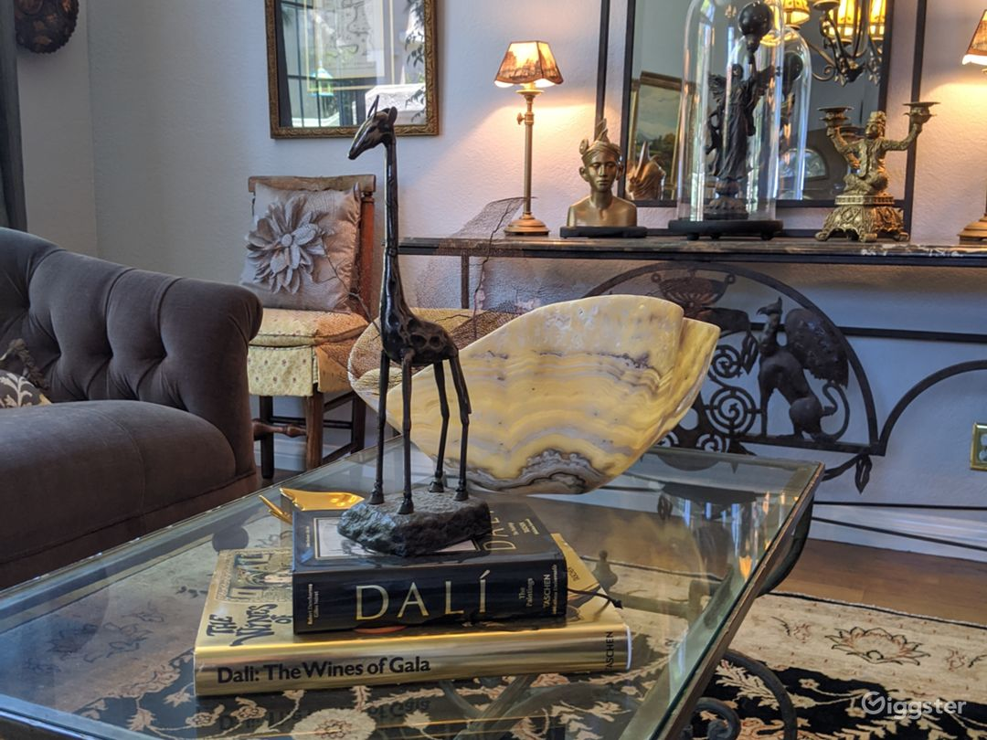 Matching gray velvet couches in formal living room with French iron coffee table