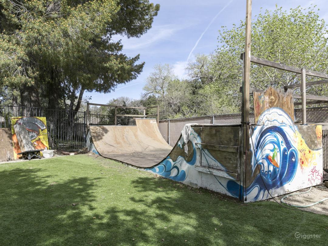 English Tudor Style With Skateboard Ramp In Yard Photo 2