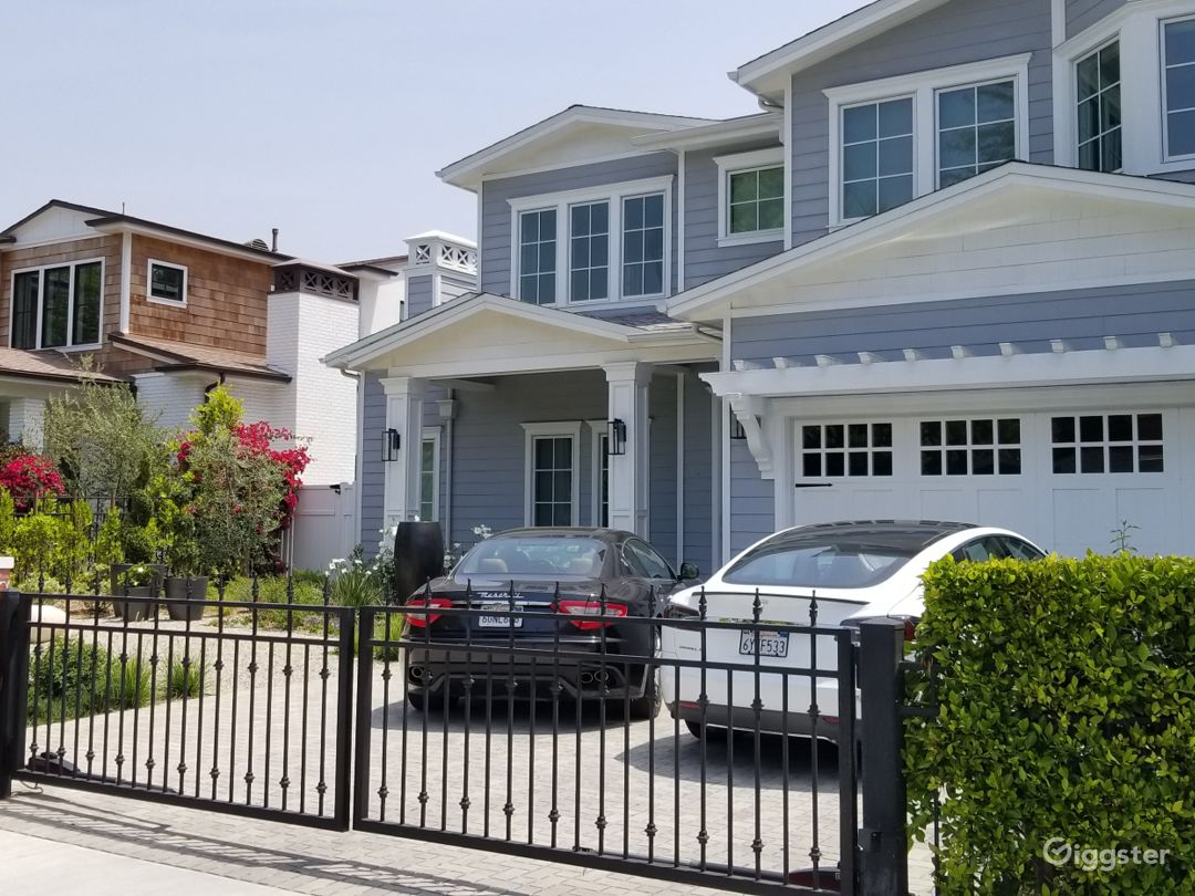 Front yard landscaping with water feature with car gates closed