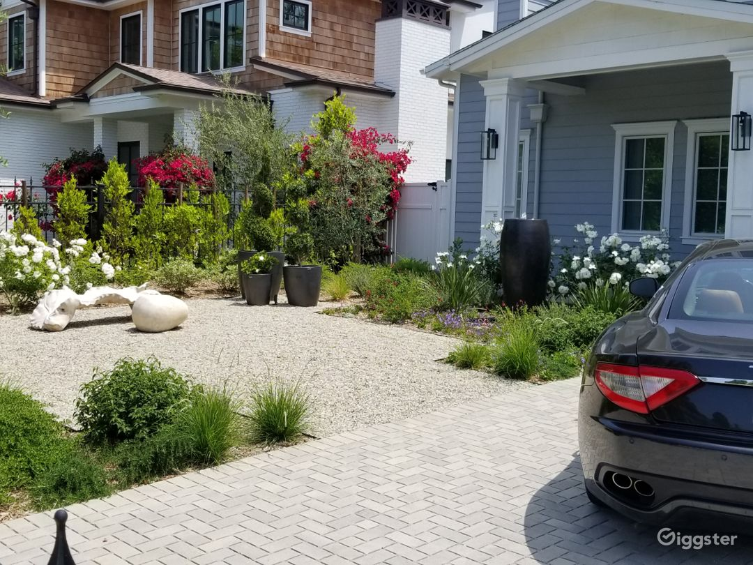 New upgraded front yard landscaping with water feature