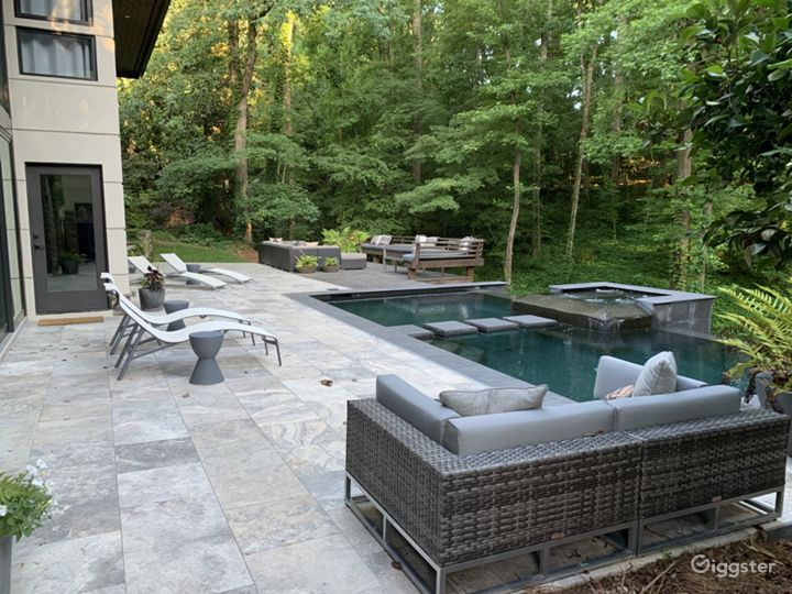 Side view of outdoor space with pool and spa