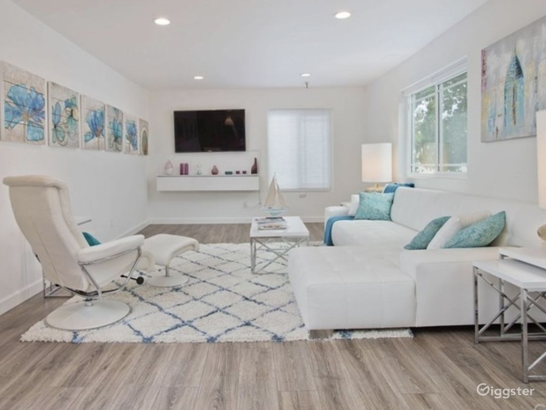 Enjoy a beach front upscale Hamptons vibe in this designer finished living room