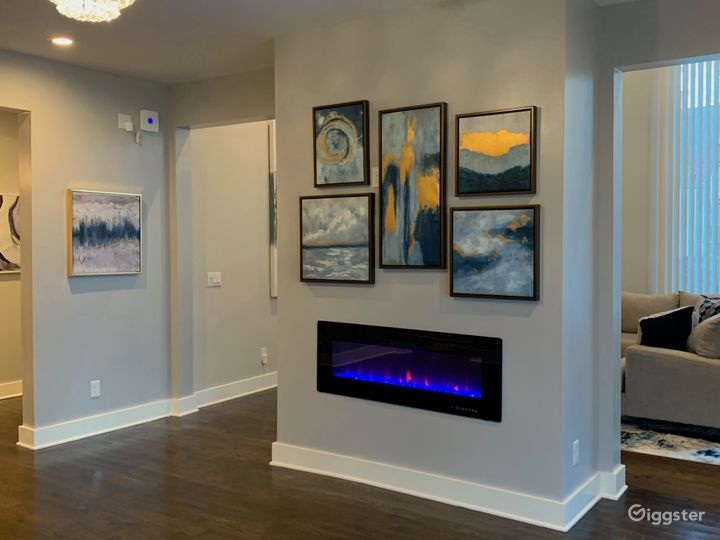 foyer Fire place that changes to multiple colors with art wall above.