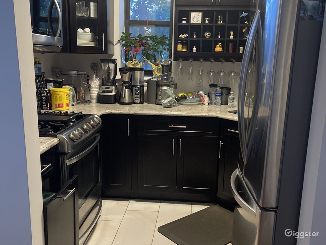 New kitchen with granite countertop and stainless stainless appliances.