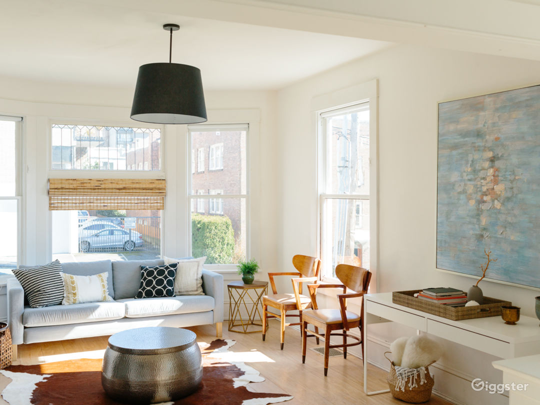 Light flooded living room with original leaded glass bay windows