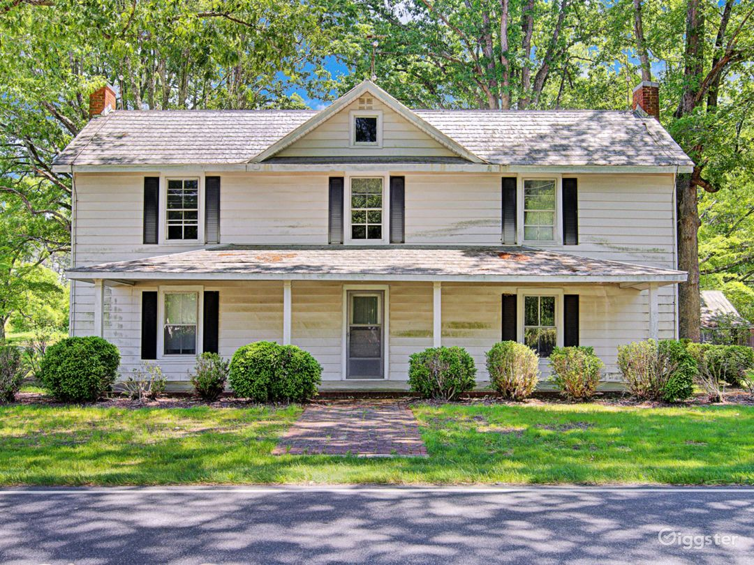 Two-story 1850s farmhouse with original details like built-ins, delicate glass doors and light fixtures.