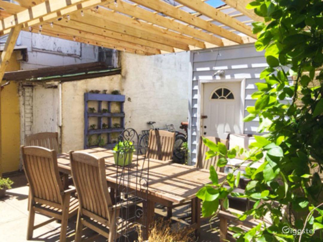 Vibrant Backyard With Table Photo 1