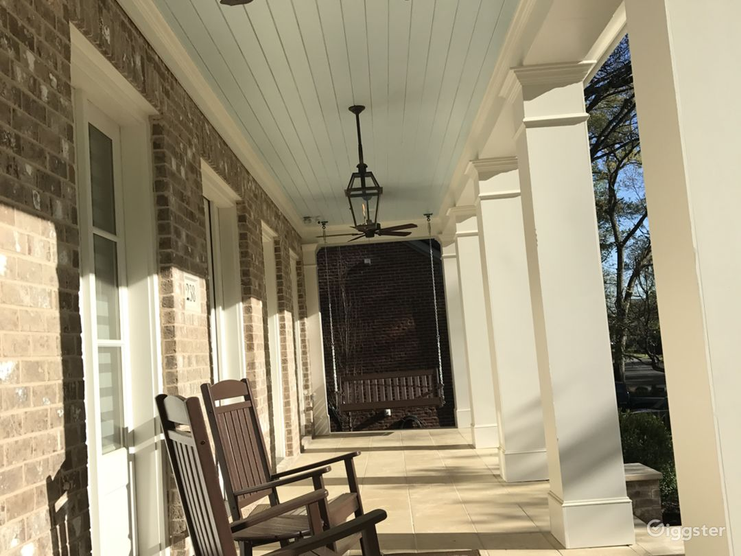 Front Porch with blue ceiling, rocking chairs.  Wide and long porch.