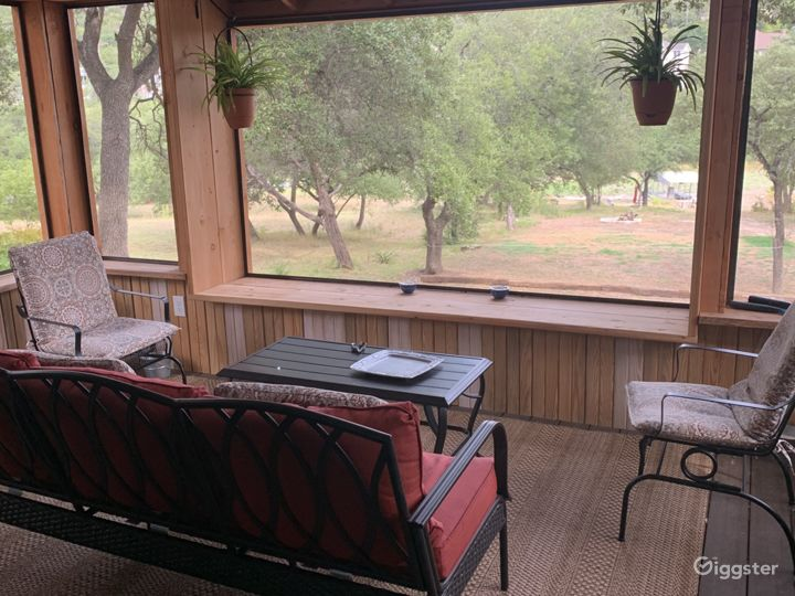 The porch is by far a huge draw with custom benches and screened in all around.
