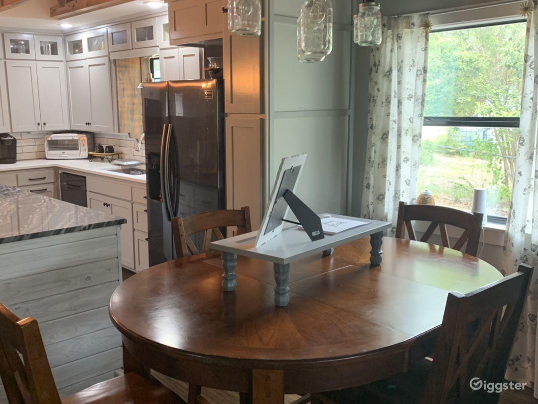 Recently remodeled kitchen with all new appliances and high top table bring current feel to cozy atmosphere.
