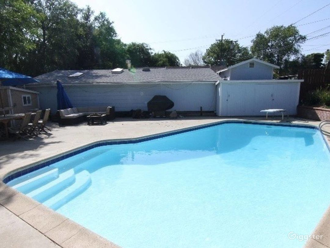 Large pool, diving board, pool lounge, pool area,
