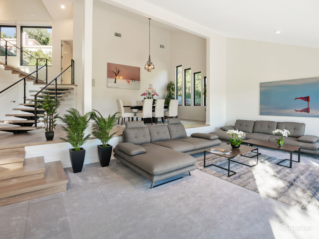 Clean Modern minimal lines with pops of color Open Floor plan with high ceilings Floating Metal Staircase with Wood Steps
