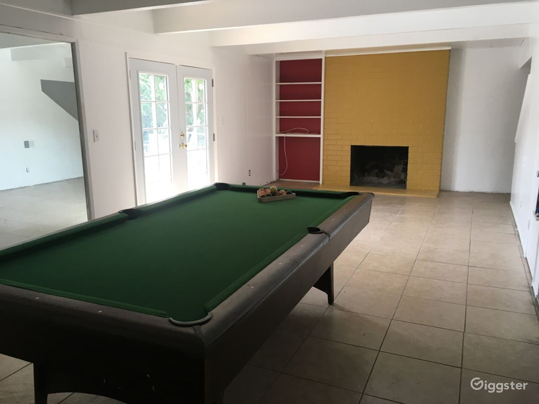 Main 450 sqft space.  French doors open out to sand & pool deck.  Pool table can be moved outside.