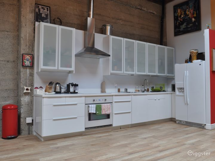 Fully equipped kitchen with stainless steel appliances,