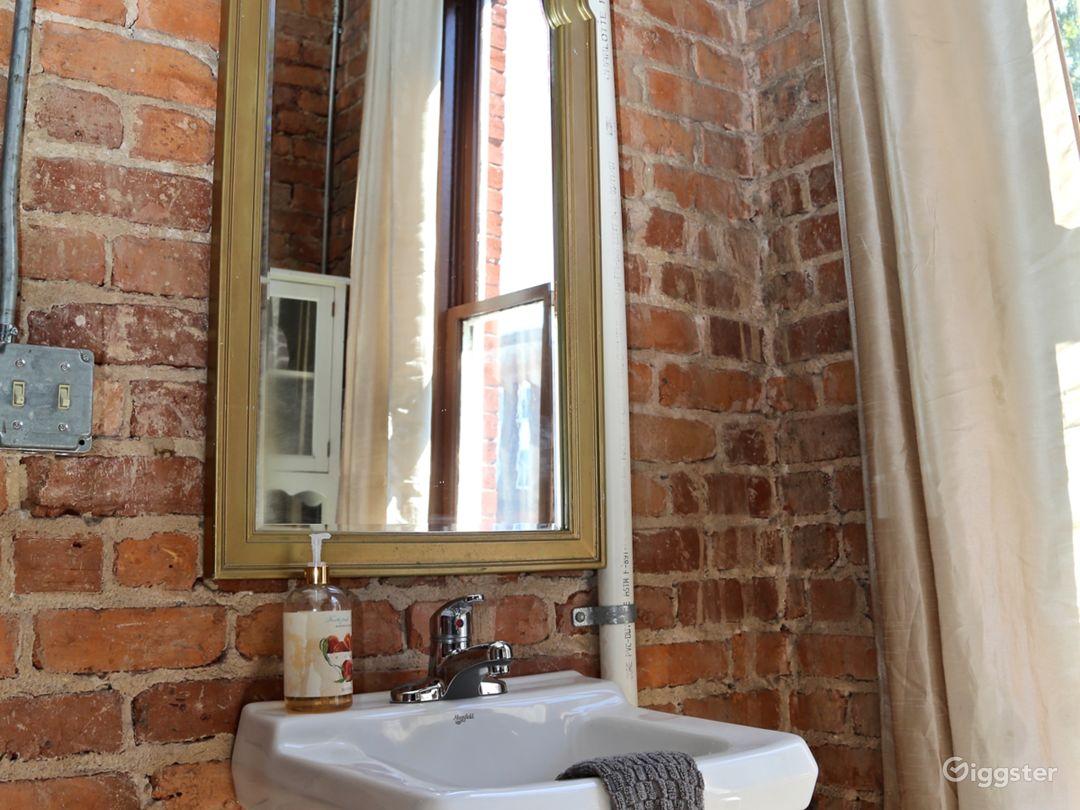 Bathroom with Exposed brick