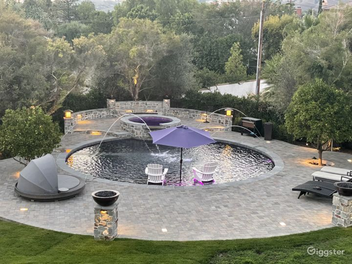 Luxurious Round Craftsman Pool and Huge Backyard Photo 3