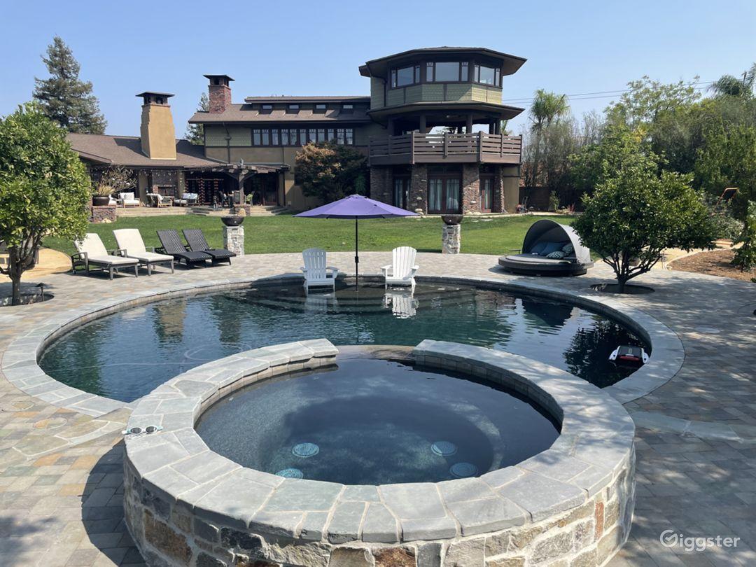 Luxurious Round Craftsman Pool and Huge Backyard Photo 1