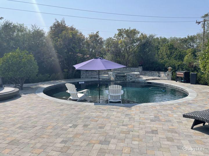 Luxurious Round Craftsman Pool and Huge Backyard Photo 5