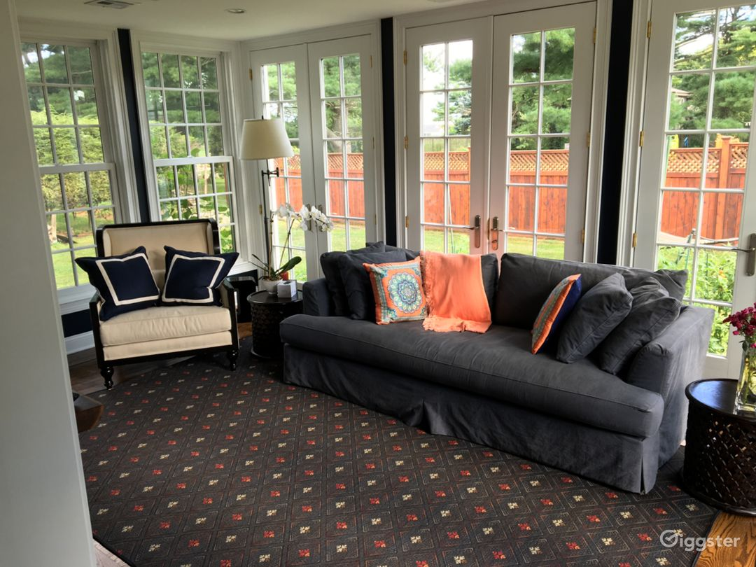 Fantastic room featuring floor to ceiling windows and French doors