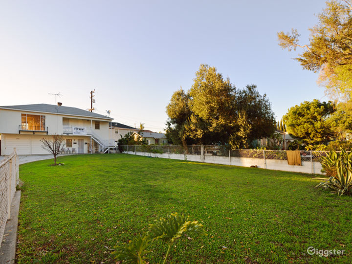 Unusual home with views of long driveway and yard. Photo 3