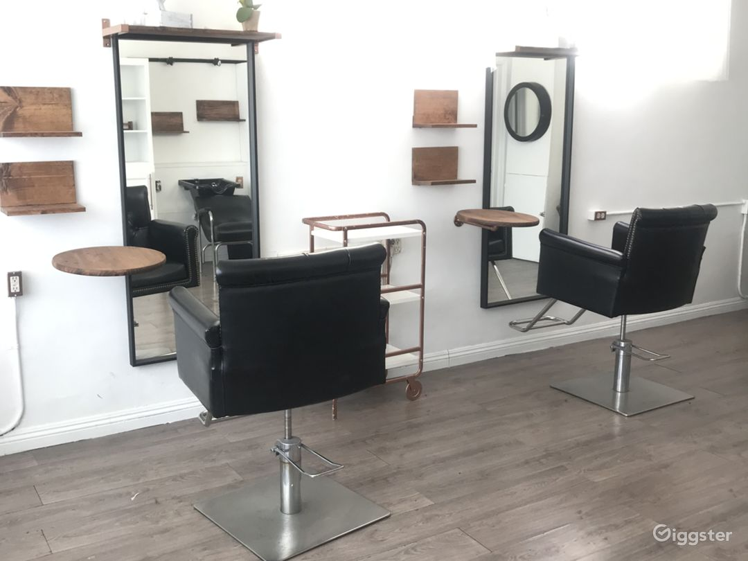 Double station hair salon 2 black tufted chairs can be moved around