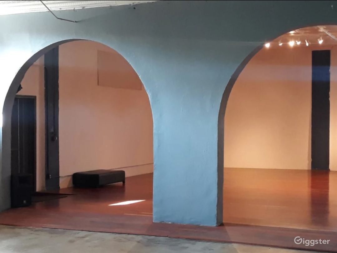 Arches divide studio and foyer; closed by curtain.